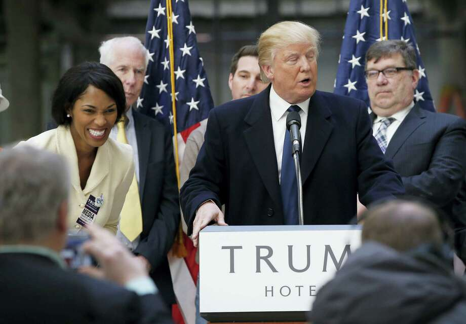 Alicia Watkins of Gaithersburg, Md., left, reacts as she talks to Republican presidential candidate Donald Trump after asking him for a job, while he was speaking during a campaign event in the atrium of the Old Post Office Pavilion, soon to be a Trump International Hotel, Monday in Washington. Photo: Alex Brandon — The Associated Press  / AP