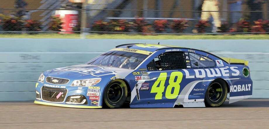 Jimmie Johnson drives during Sunday's race in Homestead, Fla. Photo: Terry Renna — The Associated Press  / FR60642