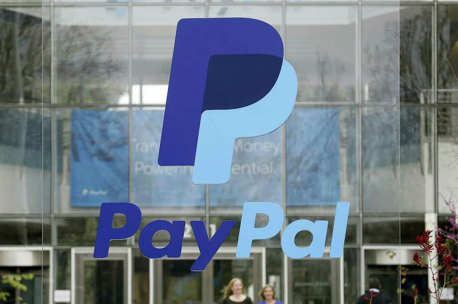 This March 10, 2015 photo shows signage outside PayPal headquarters in San Jose, Calif. PayPal shares jumped in its first day as a separate and publicly traded company on July 20, 2015, as it outlined plans to capitalize on the rise of mobile payments and the growing digitization of money. Photo: AP Photo/Jeff Chiu  / AP