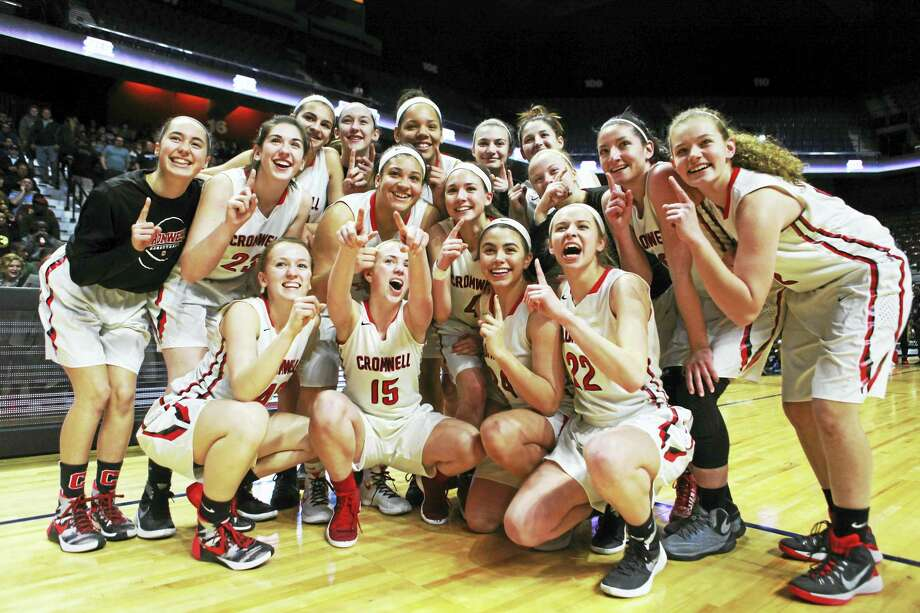 The Cromwell girls basketball team celebrates after completing a perfect 28-0 season Saturday at The Mohegan Sun Arena. Photo: Laura Matesky - Special For The Press
