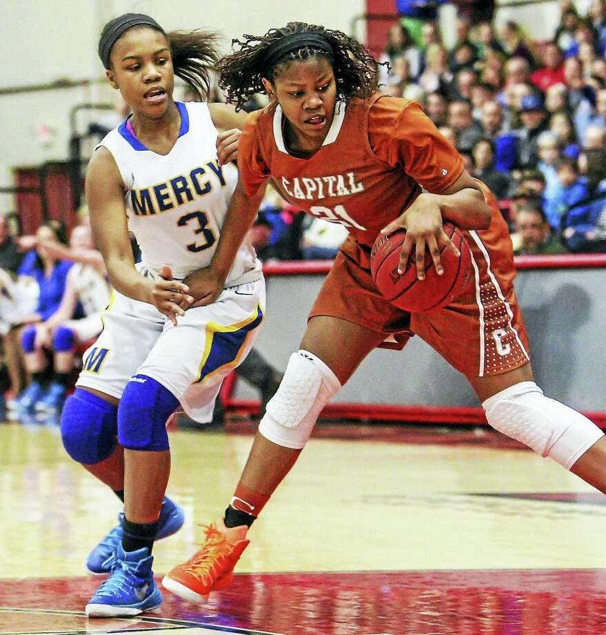 Mercy's Destine Perry goes up against Capital Prep's Desiree Elmore during last year's mega-clash. Photo: Photo By Catherine Avalone — GameTime CT  / John Vanacore/REGISTER