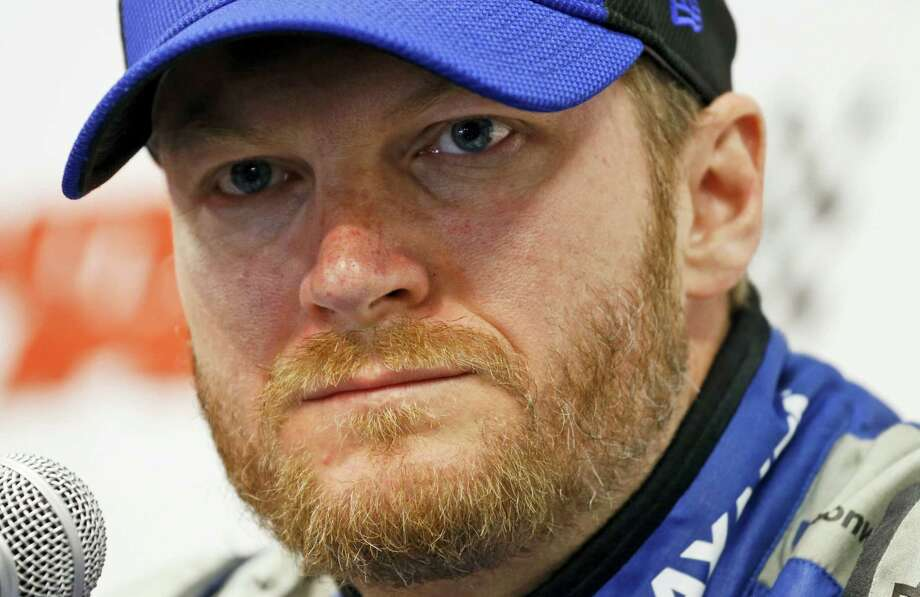 In this April 1, 2016 photo, Sprint Cup driver Dale Earnhardt Jr., speaks to the media during a press conference at the Martinsville Speedway in Martinsville, Va. Photo: AP Photo/Steve Helber, File  / Copyright 2016 The Associated Press. All rights reserved. This material may not be published, broadcast, rewritten or redistribu