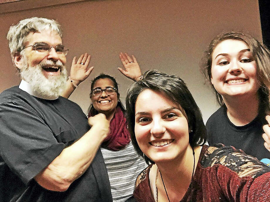 Brother Guy Consolmagno poses for a selfie with Mercy High School students Maria Socarras (background,) Michelle Orlando and Emily Tyler. Photo: Courtesy Photo