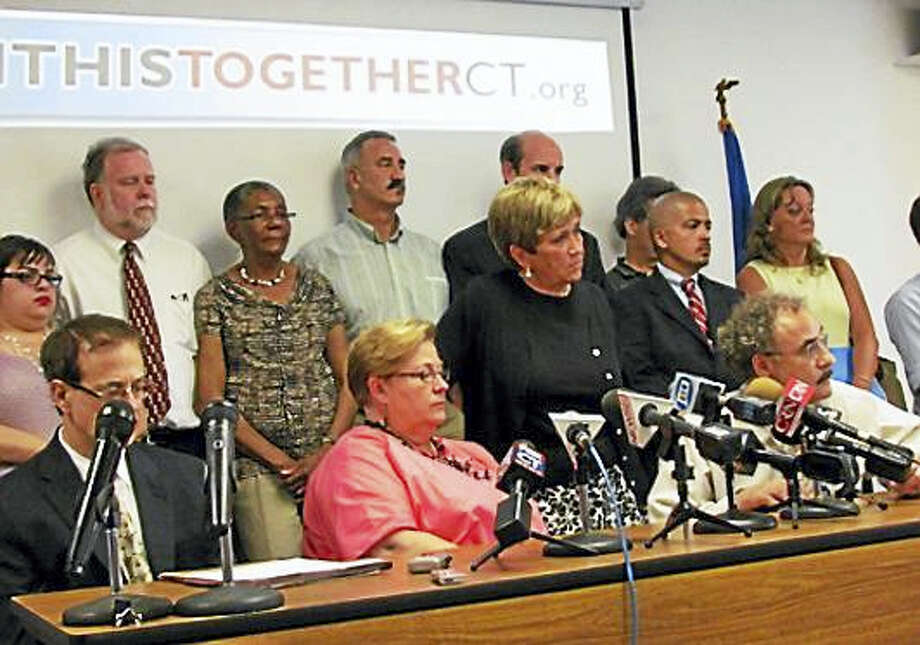 The heads of Connecticut's labor unions following the signing of the 2011 labor contract. Photo: Journal Register Co.