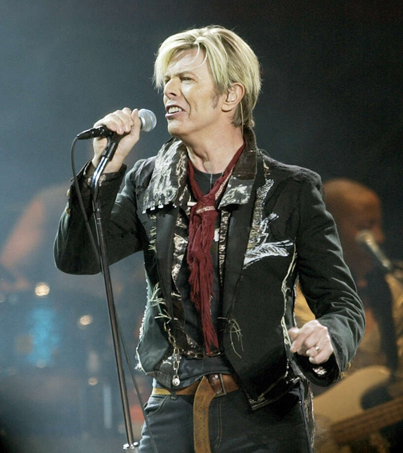 "In this Dec. 15, 2003 photo, singer/songwriter David Bowie launches his United States leg of his worldwide tour called ""A Reality Tour,"" at Madison Square Garden in New York. Bowie died Jan. 10, 2016 after battling cancer. Photo: AP Photo/Kathy Willens, File  / AP"