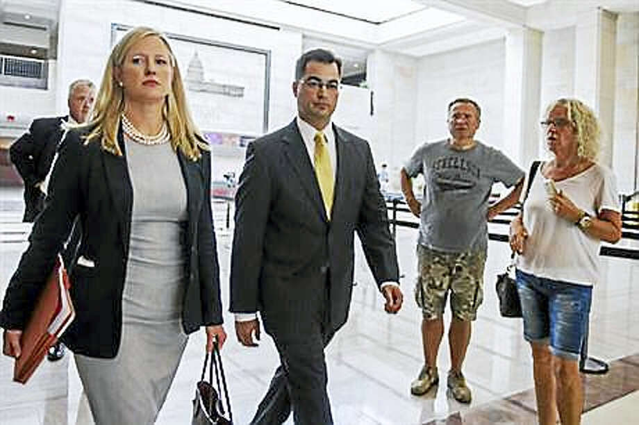 In this Sept. 10, 2015, file photo, Bryan Pagliano, center, a former State Department employee who helped set up and maintain a private email server used by Hillary Rodham Clinton, departs Capitol Hill in Washington. House Republicans on Tuesday, Sept. 13, 2016, continue their attacks on former Secretary of State Clinton's emails by calling the tech expert who set up her private server and representatives from the company that maintained the system to testify at a congressional hearing. Pagliano, a former information resource management adviser at the State Department, is scheduled to appear Tuesday before the Oversight and Government Reform Committee. Photo: AP Photo/Cliff Owen, Lee, File