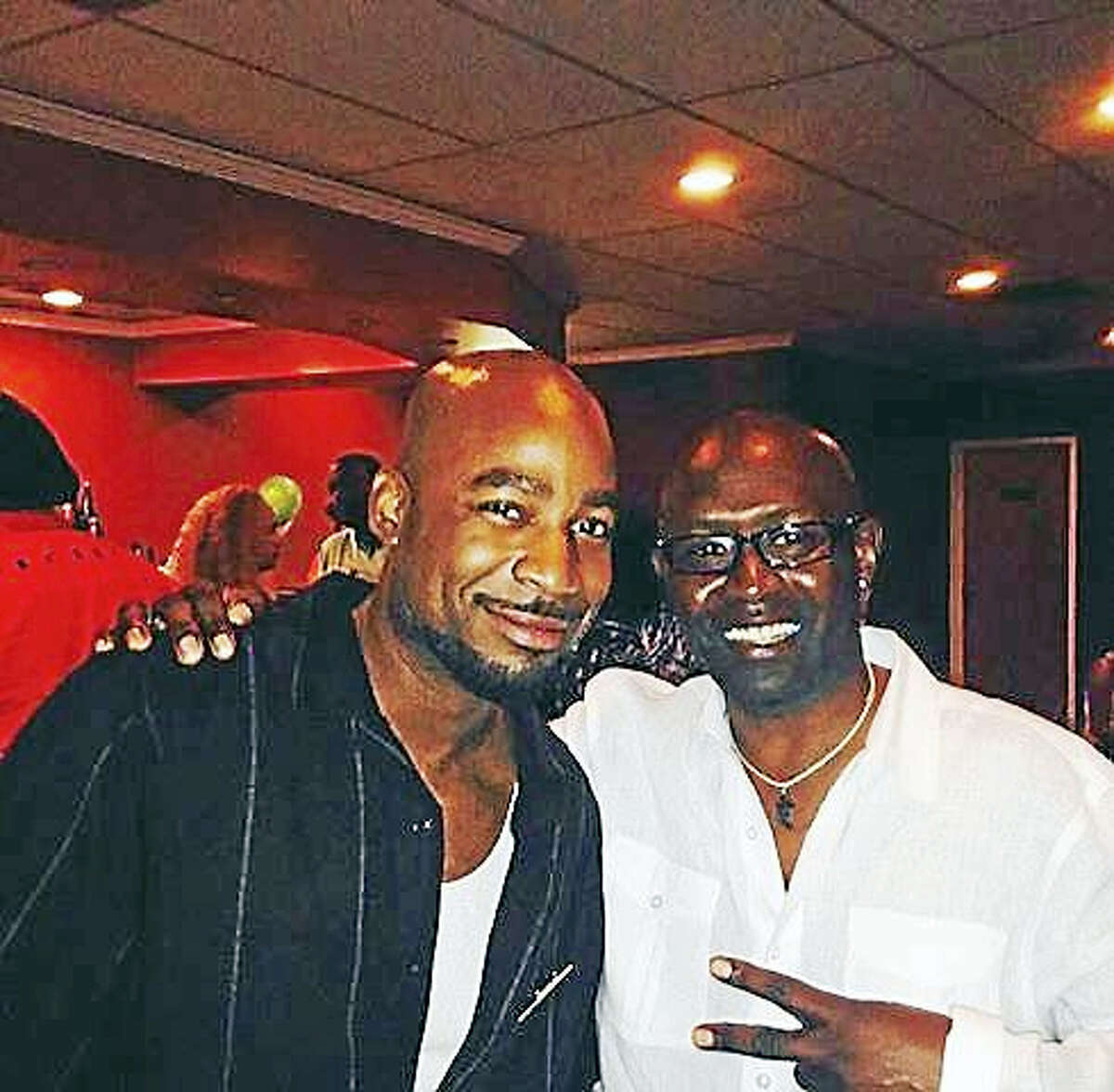 """Donzie Taylor, left, is shown with his longtime friend Kelvin Young, who says the two shared a love of """"real"""" hip-hop music in the 1990s."""