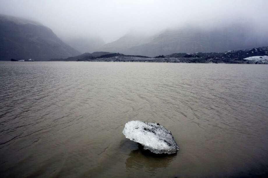 An ice floe floats on a lake in front of the Solheimajokull glacier, where the ice has retreated by more than 1 kilometer (0.6 miles) since annual measurements began in 1931. Photo: File Photo  / AP