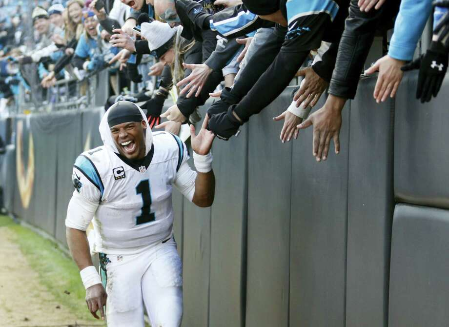 Panthers quarterback Cam Newton (1) celebrates with fans after beating the Seahawks on Sunday. Photo: Bobh Leverone — The Associated Press  / FR170480 AP