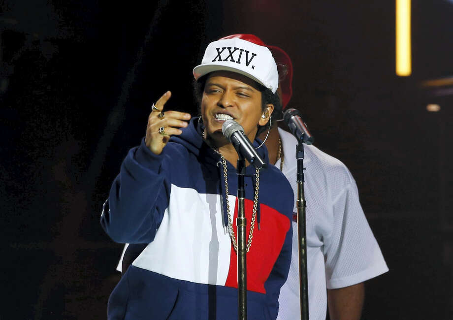 In this Nov. 6, 2016 photo, Bruno Mars performs during the MTV European Music Awards 2016, in Rotterdam, Netherlands.  With new albums to promote, timing is perfect for the American Music Awards Sunday, Nov. 20, where performers include top pop stars such as Lady Gaga, Bruno Mars and the Weeknd. Photo: AP Photo/Peter Dejong  / Copyright 2016 The Associated Press. All rights reserved.