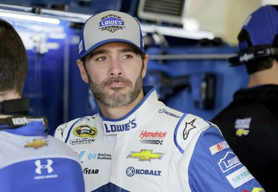 Jimmie Johnson watches his crew work in the garage area before practice Friday in Homestead, Fla. Photo: Terry Renna — The Associated Press  / FR60642