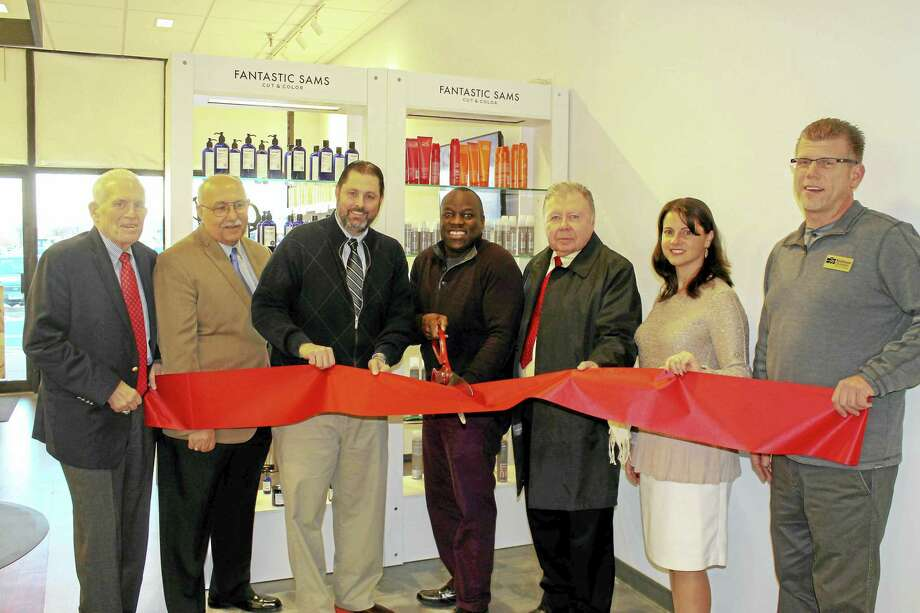Fantastic Sams at 51 Shunpike Road in Cromwell held a grand opening recently. From left are: Middlesex Chamber President Larry McHugh, Cromwell Town Manager Anthony J. Salvatore, Mayor Enzo Faienza, Fantastic Sams owner Jay Oboma, chamber Cromwell Division chair Jay Polke, state Rep. Christie Carpino, and Cromwell Downtown Merchants Association co-chair Rodney Bitgood. Photo: Courtesy Photo