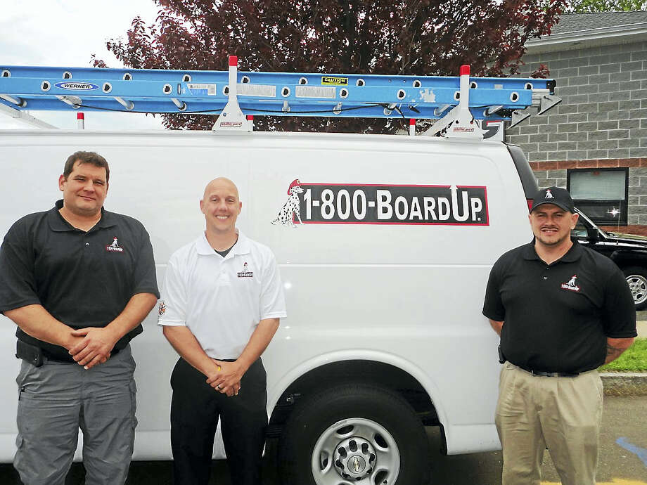 From left are 1-800-BOARDUP loss specialist Brian Soule, director of operations Dan Huften and president Danny Strong at the company's North Main Street office. Photo: Contributed Photo
