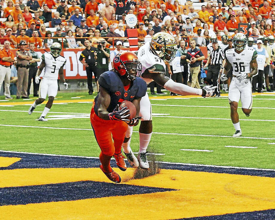 Syracuse's Ervin Philips catches a touchdown pass against South Florida. The former West Haven star is third in the FBS with 30 receptions. Photo: Photo Courtesy Of Syracuse Athletics