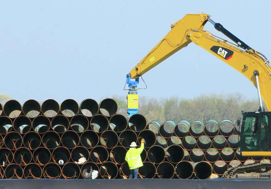 Pipes for the proposed Dakota Access oil pipeline that will stretch from the Bakken oil fields in North Dakota to Illinois are stacked at a staging area in Worthing, S.D. Photo: Nati Harnik — The Associated Press  / Copyright 2016 The Associated Press. All rights reserved. This material may not be published, broadcast, rewritten or redistribu