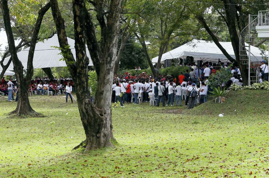 Hundreds of followers attend a mass at the graveyard of the late Philippine dictator Ferdinand Marcos, Saturday, Nov. 19, 2016, a day after he was buried at the Heroes' Cemetery in suburban Taguig city, Philippines. Family members and followers of the late president have gathered for a vigil at his tomb a day after his secrecy-shrouded burial at the country's Heroes' Cemetery triggered protests. Photo: AP Photo/Bullit Marquez   / Copyright 2016 The Associated Press. All rights reserved.