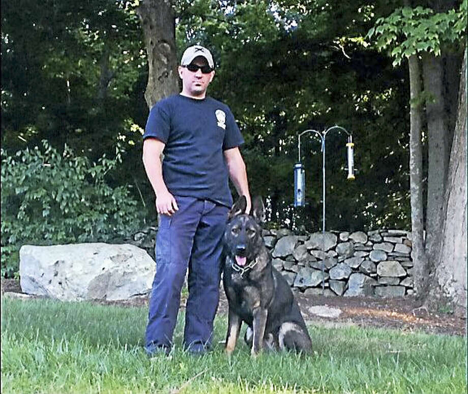 Portland police Sgt. James Kelly and a 13-month-old sable German shepherd candidate for the position of canine officer in town. Photo: CONTRIBUTED PHOTO —  Sgt. James Kelly