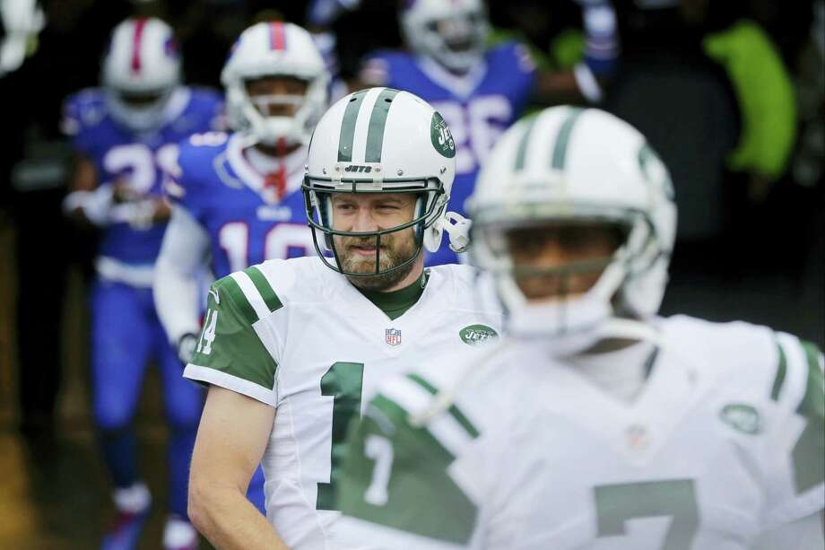 New York Jets general manager Mike Maccagnan says the team remains focused on trying to re-sign quarterback Ryan Fitzpatrick, although it also has contingency plans. Photo: The Associated Press File Photo  / FR170745 AP