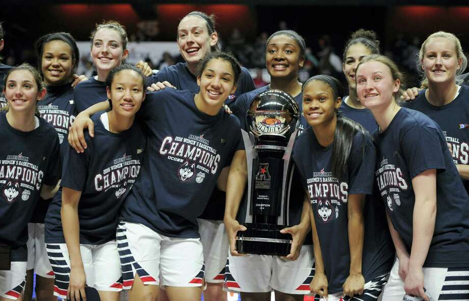 FILE- In this March 7, 2016, file photo, Connecticut players pose with the championship trophy at the end of a NCAA college basketball game in the American Athletic Conference tournament finals against South Florida at Mohegan Sun Arena in Uncasville, Conn. UConn was the top overall seed in the women's NCAA Tournament that was revealed Monday, March 14, 2016. (AP Photo/Jessica Hill, File) Photo: AP / FR125654 AP