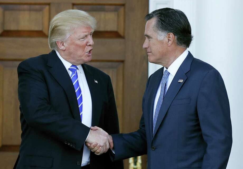 President-elect Donald Trump and Mitt Romney shake hands as Romney leaves Trump National Golf Club Bedminster in Bedminster, N.J., Saturday, Nov. 19, 2016. Photo: Carolyn Kaster — AP Photo / Copyright 2016 The Associated Press. All rights reserved.