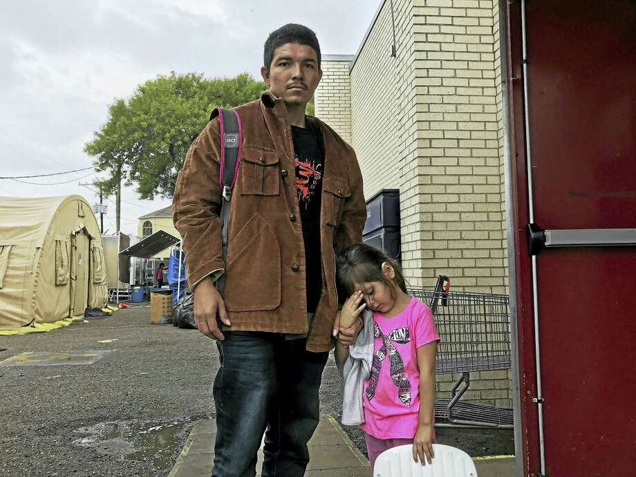 Ever Javier Palma Romero, 24, a fish processor from coastal El Salvador, with his daughter, Jackeline, 4, faced gang threats in his home town and decided to flee to the United States. Photo: Photo By: Josh Partlow — The Washington Post / The Washington Post