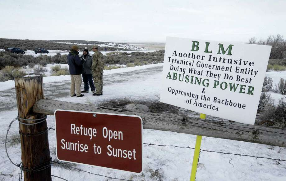 In this Monday, Jan. 4, 2016, file photo, Members of the group occupying  the Malheur National Wildlife Refuge headquarters stand guard near Burns, Ore. Thousands of archeological artifacts and maps detailing where more can be found are stored at a national wildlife refuge currently being held by a group of armed protestors. Photo: AP Photo/Rick Bowmer, File   / AP