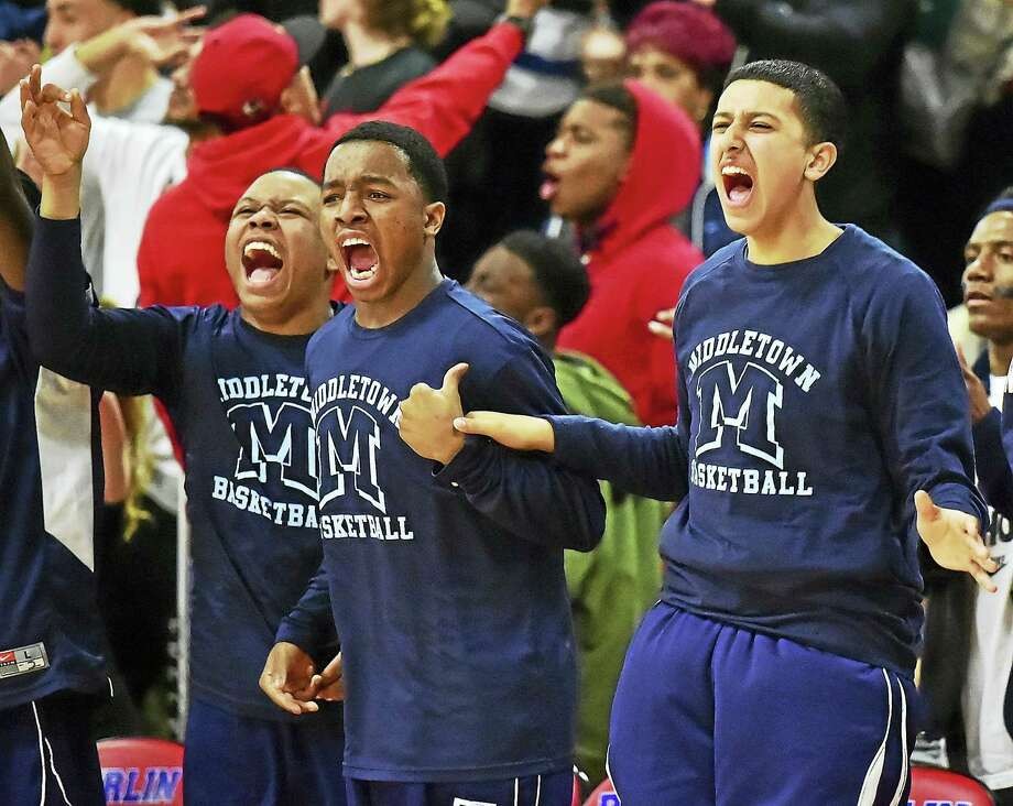The Middletown boys basketball team's Run to the Sun included a memorable overtime win over Newington. The Blue Dragons meet East Catholic tonight (8:15 p.m.) for the Class L title. Photo: Catherine Avalone - New Haven Register  / New Haven RegisterThe Middletown Press