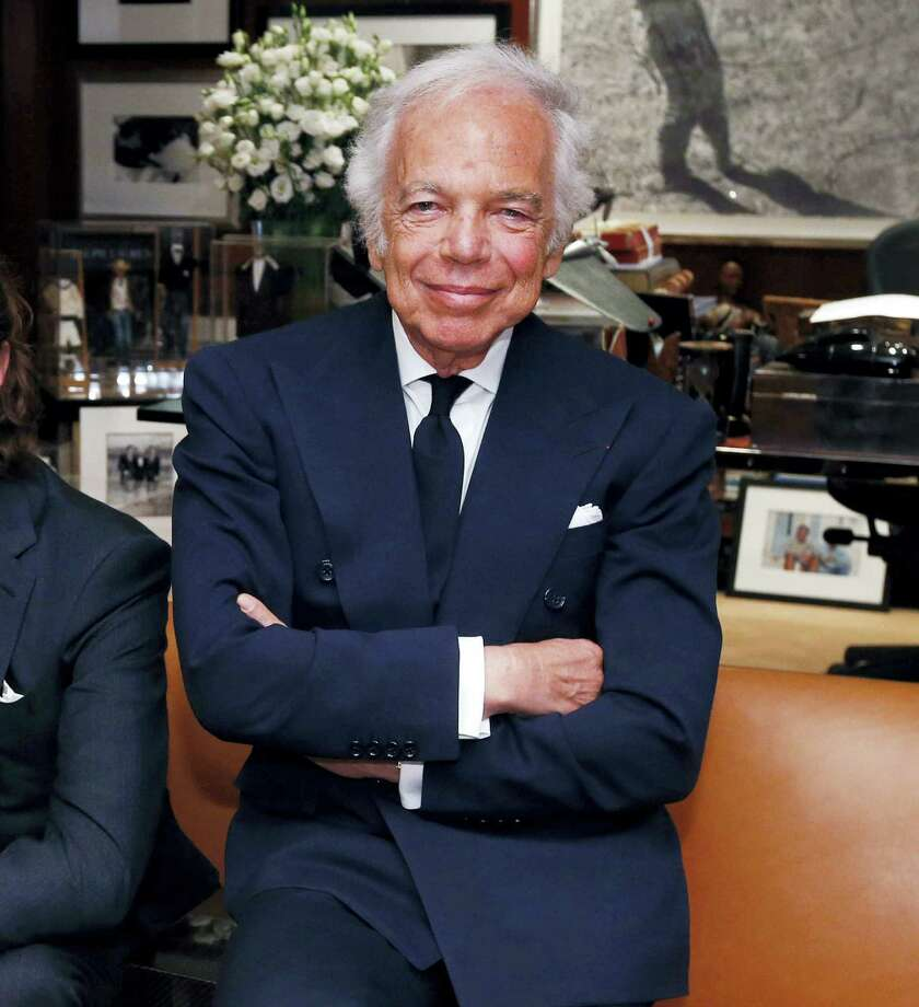 In this Sept. 29, 2015 photo, designer Ralph Lauren poses in his office in New York. Lauren, one of the giants of modern American fashion, is working on his autobiography. Simon & Schuster said Sept. 21, 2016, that it will release the book in the Fall 2017, in conjunction with his company's 50th anniversary. Photo: AP Photo/Jason DeCrow, File  / FR103966 AP