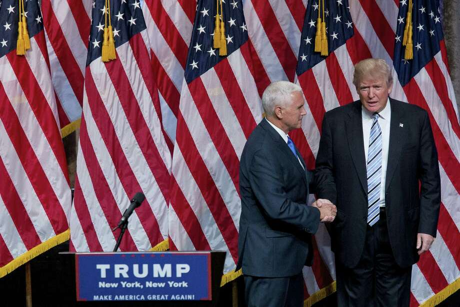 Republican presidential candidate Donald Trump, right, and Gov. Mike Pence, R-Ind., shake hands during a campaign event to announce Pence as the vice presidential running mate on, Saturday, July 16, 2016, in New York. In their first joint appearance, Trump tried to draw a sharp contrast between Pence, a soft-spoken conservative, and Hillary Clinton, the Democratic presidential candidate. Photo: AP Photo — Mary Altaffer / AP