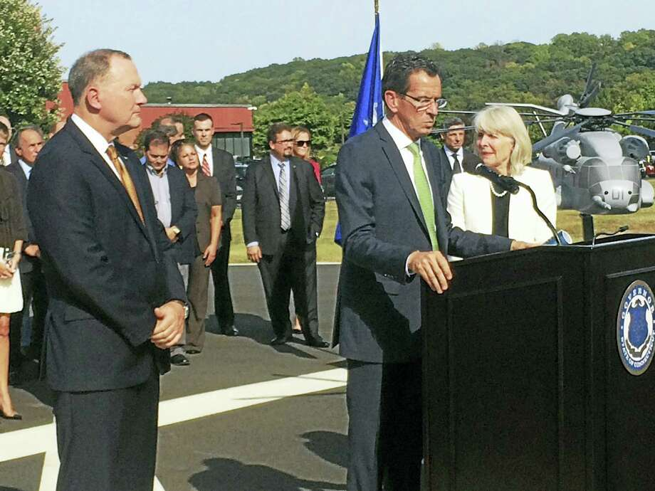 From left, Sikorsky Aircraft President Dan Schultz, Gov. Dannel Malloy and state Department of Economic and Community Development  Commissioner  Catherine Smith discuss the state's deal with the helicopter maker at a press conference in Stratford Wednesday. A model of the CH-53K, a new helicopter Sikorsky will build in Connecticut, is shown at far right. Photo: LUTHER TURMELLE — NEW HAVEN REGISTER