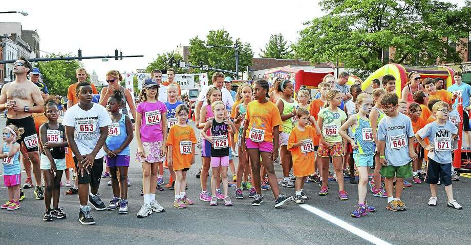 File photo  Children crowd the starting line moments before the start of last year's Citizens Bank half-mile kids fun run in downtown Middletown. After children raced along a portion of a Main Street and back, the adults ran a two-loop 5K course through the Wesleyan University campus and back downtown. Photo: Journal Register Co.