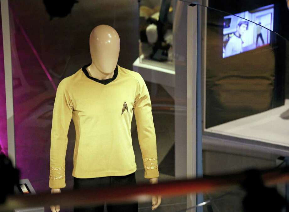 "In this photo taken Wednesday, May 18, the original tunic worn by Capt. James T. Kirk, played by William Shatner, is displayed in the exhibit, ""Star Trek: Exploring New Worlds,"" as part of a 50th anniversary celebration of the TV show and films at the EMP Museum, in Seattle. The exhibit opens Saturday. Photo: Elaine Thompson — The Associated Press  / Copyright 2016 The Associated Press. All rights reserved. This material may not be published, broadcast, rewritten or redistribu"