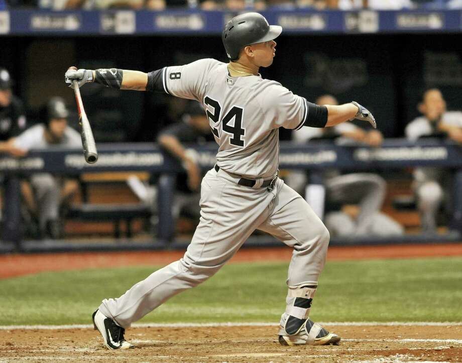 New York catcher Gary Sanchez hits a three-run homer off Tampa Bay Rays reliever Brad Boxberger during the seventh inning Tuesday. The Yankees won 5-3. Photo: STEVE NESIUS — THE ASSOCIATED PRESS  / FR69810 AP