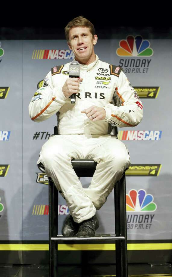 Carl Edwards answers a question during a news conference Thursday in Miami Beach, Fla. Photo: Alan Diaz — The Associated Press  / Copyright 2016 The Associated Press. All rights reserved.