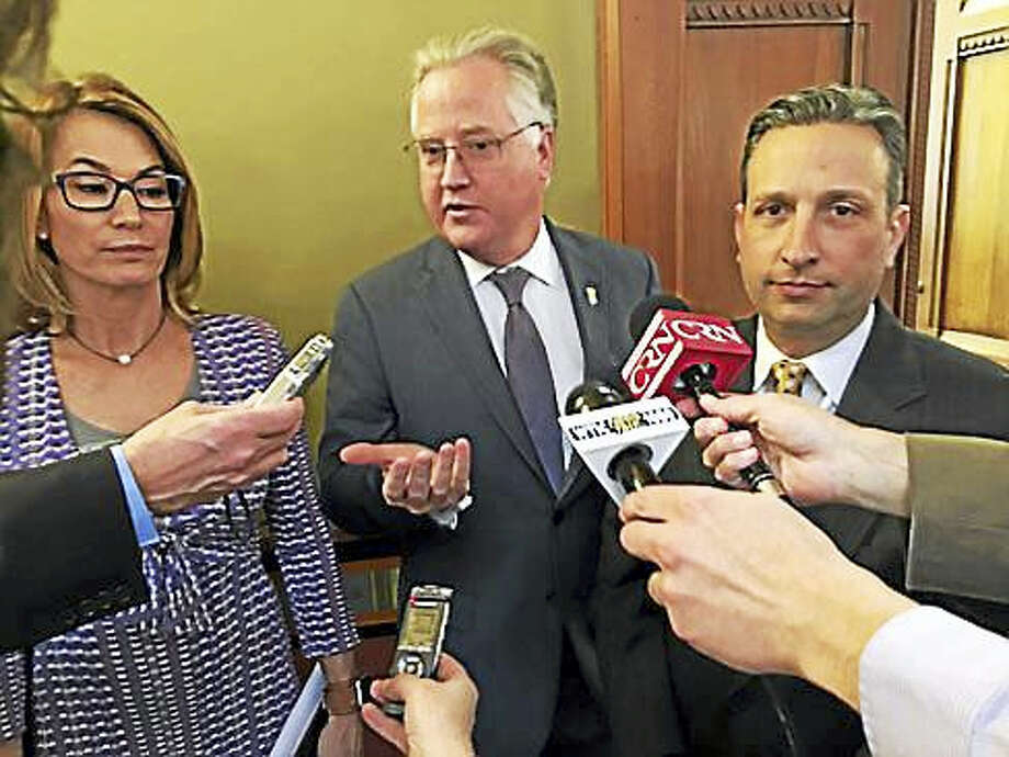 House Speaker Brendan Sharkey, center, with House Minority Leader Themis Klarides, left, and Senate Majority Leader Bob Duff exit Gov. Dannel P. Malloy's office. Photo: Christine Stuart — CT News Junkie File Photo