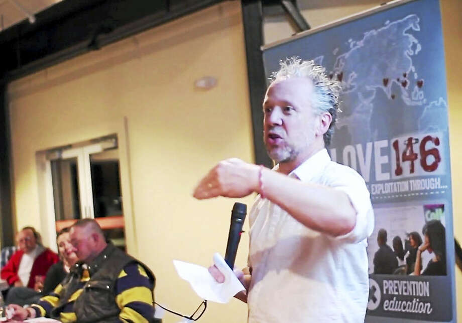 Rob Morris, president and co-founder of Love146, speaks at a 2015 fundraiser at Stony Creek Brewery in Branford. Photo: CONTRIBUTED Photo — Love146