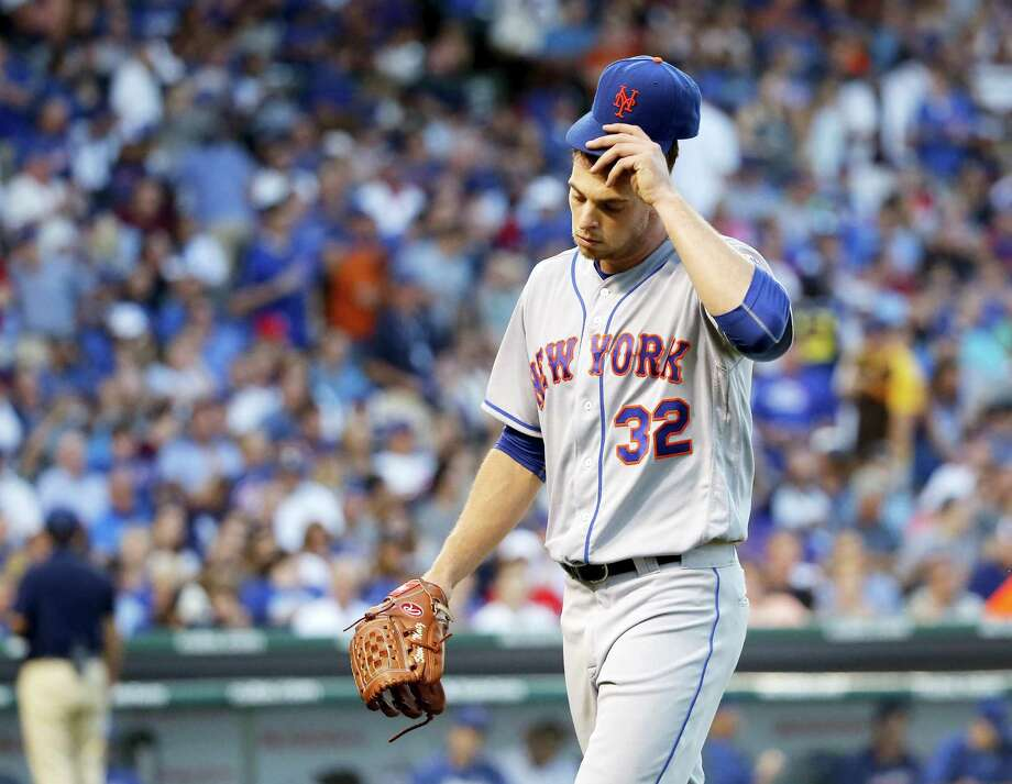 Mets starting pitcher Steven Matz leaves the game during the sixth inning on Monday. Photo: Charles Rex Arbogast — The Associated Press  / Copyright 2016 The Associated Press. All rights reserved. This material may not be published, broadcast, rewritten or redistribu