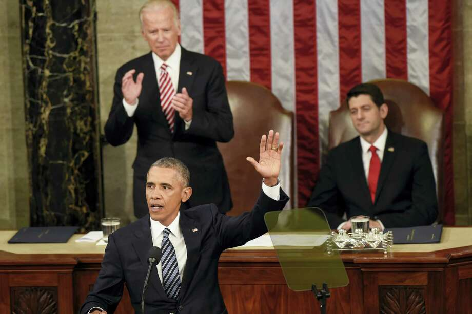 ASSOCIATED PRESS President Barack Obama waves goodbye after giving his final State of the Union address before a joint session of Congress on Capitol Hill in Washington, Tuesday. Vice President Joe Biden applauds; House Speaker Paul Ryan of Wisconsin is at right. Photo: AP / AP