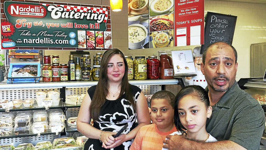Hani Shehata, far right, his wife Suzan, left, and children Jacob, 8, and Emily, 10, are shown at the family business, Nardelli's Grinder Shoppe in Cromwell. The family recently donated sandwiches and salad to the Connecticut State Police and Cromwell police to show their support after recent police shootings in Dallas. Photo: Wes Duplantier — New Haven Register)