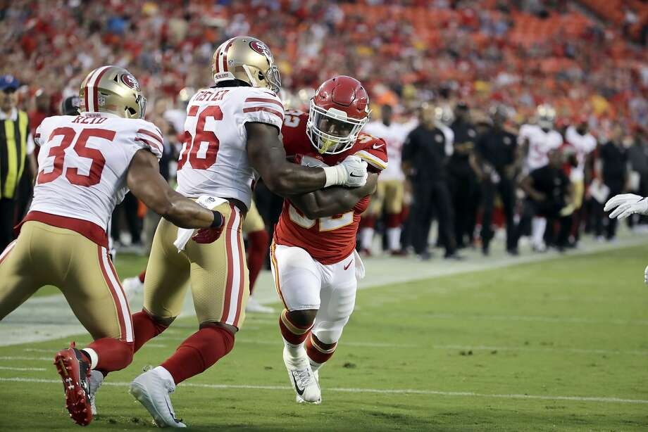 Kansas City Chiefs running back Spencer Ware (32) tries to get past San Francisco 49ers linebacker Reuben Foster (56) and safety Eric Reid (35) during the first half of an NFL preseason football game in Kansas City, Mo., Friday, Aug. 11, 2017. (AP Photo/Charlie Riedel) Photo: Charlie Riedel, Associated Press