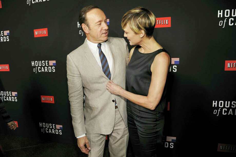 "In this Feb. 13, 2014, file photo, Kevin Spacey, left, and Robin Wright arrive at a special screening for season 2 of ""House of Cards"" in Los Angeles. The Huffington Post reported that Wright said during an interview at the Rockefeller Foundation on Tuesday, May 17, 2016, that she demanded the same pay as co--star Kevin Spacey for her work on Netflix's ""House of Cards."" Photo: Photo By Chris Pizzello/Invision/AP, File   / Invision"