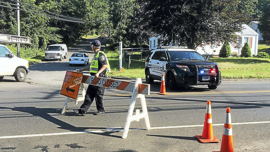 Two men died early Monday after their cars crashed head-on on Route 80 near Caputo Road in North Branford. Photo: Wes Duplantier — The New Haven Register