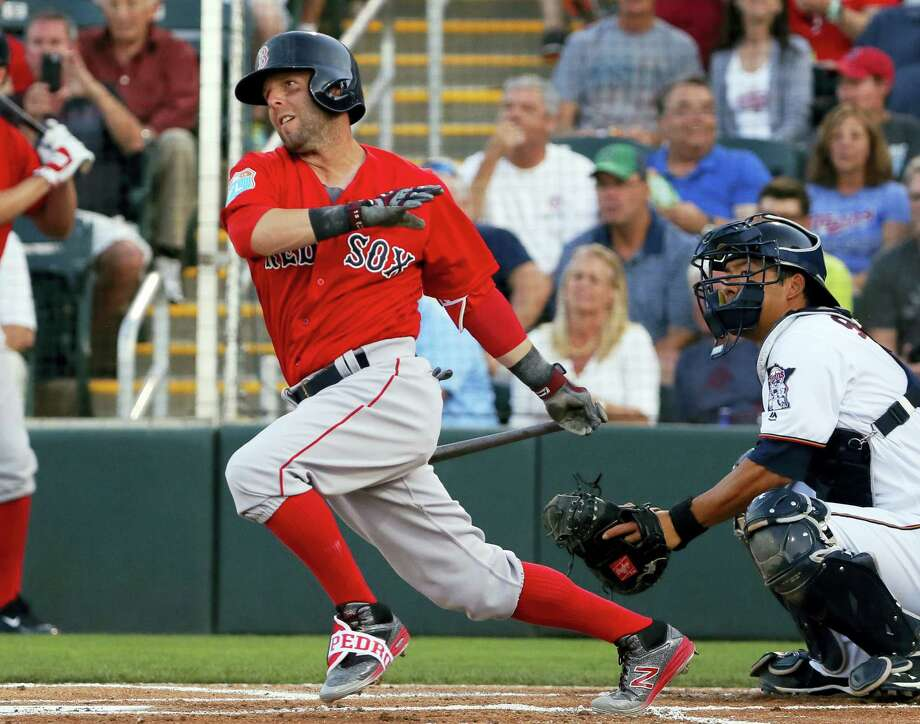 Boston Red Sox's Dustin Pedroia follows through on a ground-out in the first inning of a spring training baseball game as Minnesota Twins catcher Kurt Suzuki watches, Wednesday, March 16, 2016, in Fort Myers, Fla. The Twins won 9-4. (AP Photo/Tony Gutierrez) Photo: AP / Copyright 2016 The Associated Press. All rights reserved. This material may not be published, broadcast, rewritten or redistributed without permission.
