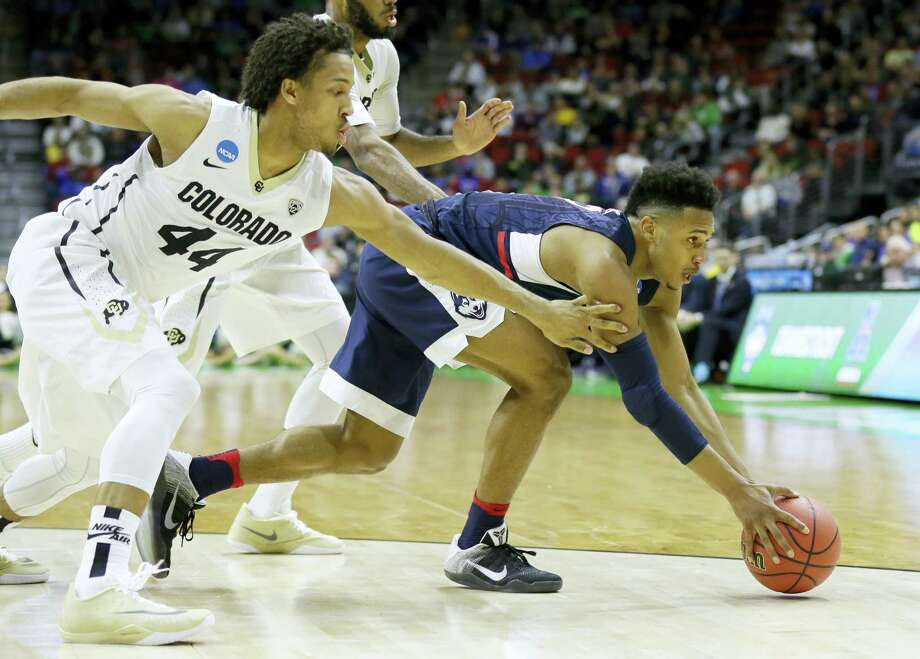 UConn guard Jalen Adams, right, fights for a loose ball with Colorado guard Josh Fortune during the first half Thursday. On Saturday, Adams will play against former Pop Warner teammate Wayne Seldon of Kansas. Photo: Charlie Neibergall — The Associated Press  / Copyright 2016 The Associated Press. All rights reserved. This material may not be published, broadcast, rewritten or redistributed without permission.