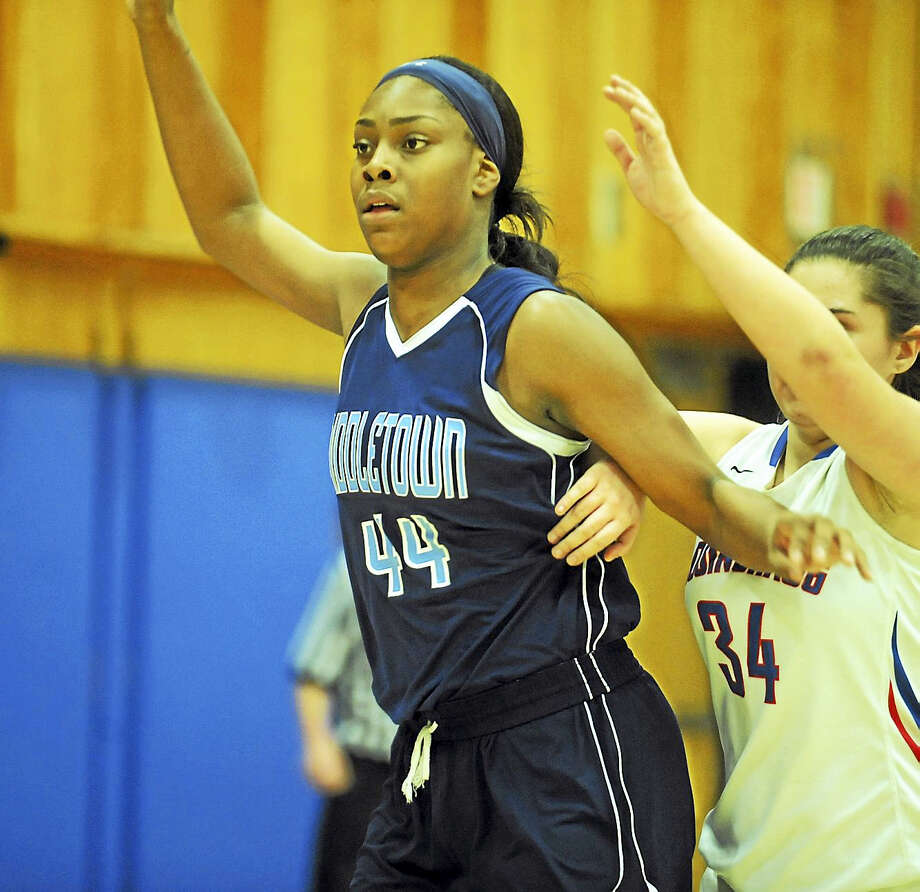 Middletown junior center Brielle Wilborn looks for the ball in the low post in the Blue Dragons' recent non-league contest against Cogicnhaug in Durham. Photo: Jimmy Zanor - The Middletown Press