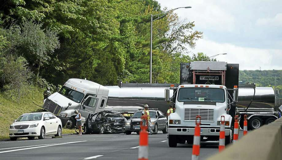 Emergency responders respond to the scene of an accident involving a tanker and a Volkswagen sedan on Route 9 northbound approximately a mile from the Randolph Road exit in Middletown on Tuesday. Photo: Catherine Avalone — New Haven Register   / New Haven RegisterThe Middletown Press