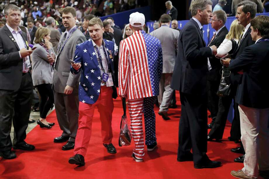 Delegates walk around the convention floor during first day of the Republican National Convention in Cleveland on Monday. Photo: ASSOCIATED PRESS  / Copyright 2016 The Associated Press. All rights reserved. This material may not be published, broadcast, rewritten or redistribu