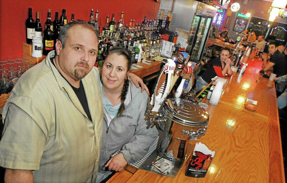 Carmela Lockwood, shown with her husband Matt Lockwood, owners of Matty's Next Door Sports Bar, Jerry's Pizza and Carmela's on the Extension, jumped at the chance to cater a breakfast for WWMS teachers and staff grieving a student's death. Photo: File Photo