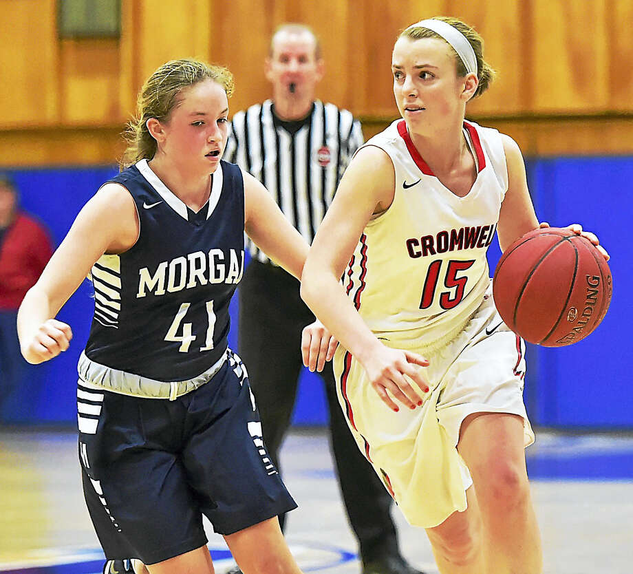 Cromwell senior Emma Belcourt looks to drive to the basket against Morgan defender Shannon Maher in the SLC championship game. Photo: Catherine Avalon – New Haven Register