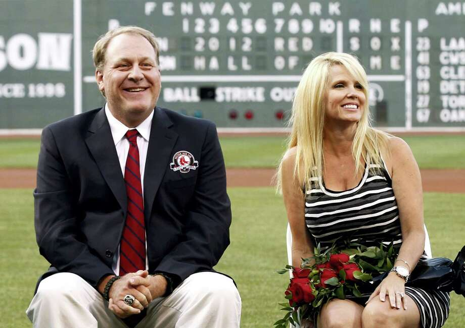 In this Aug. 3, 2012 photo, former Boston Red Sox pitcher Curt Schilling sits with his wife Shonda, right, after being introduced as a new member of the Red Sox Hall of Fame before a baseball game between the Red Sox and the Minnesota Twins at Fenway Park in Boston. Photo: AP Photo/Winslow Townson, File  / FR170221 AP
